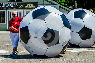 Women rolling giant soccer balls Editorial Photography