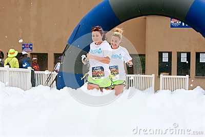 Women Run Through Blanket Of Foam At Race Finish Line Editorial Photography