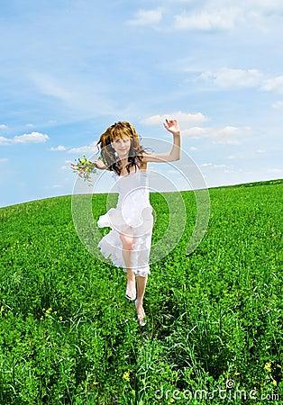 Women run on a meadow