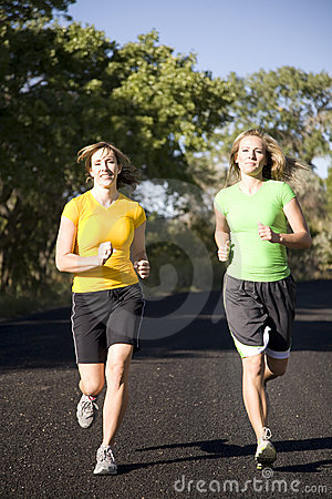 Women running on road