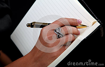 Women`s hand wrote-on the notebook