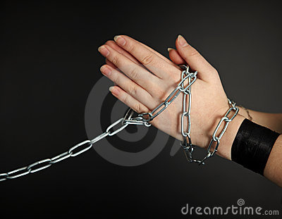 Women s hands shackled a metal chain