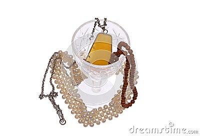 Women s jewelry and glass.