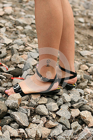 Women s legs with hieroglyph tattoo