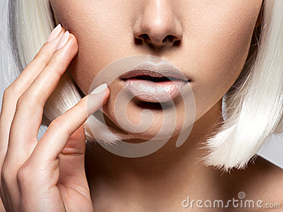 Women s lips  closeup. unrecognizable person. half face