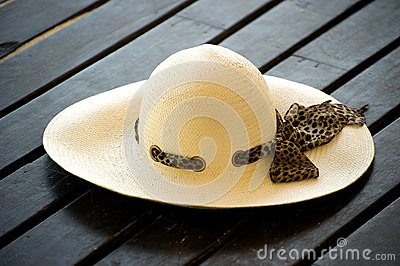 Women s sun hat on the wooden decking