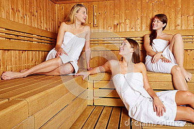 Women in sauna relaxing and talking