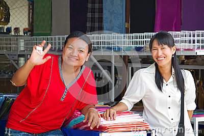 Women selling clothes on the market in Thailand Editorial Stock Image