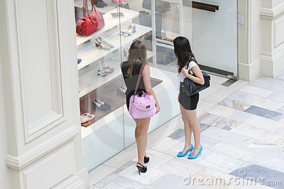 Women at shoe shop window