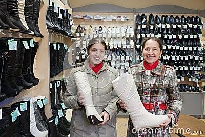 Women shopping boots at  shoe