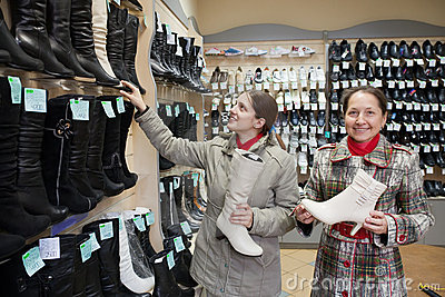 Women shopping at fashion shoe store