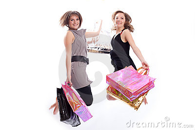 Women shopping and jumping in white