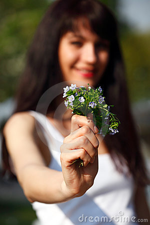 Women show a bouquet forget-me-not