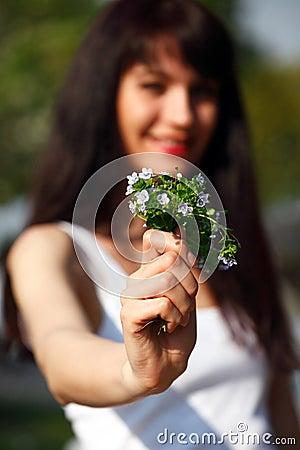 Women show a bouquet forget-me-not