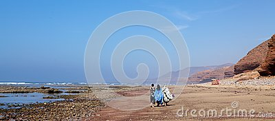 Women on the Sidi Ifni beach Editorial Stock Image