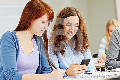 Women with smartphone in university