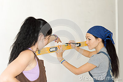 Women with spirit level