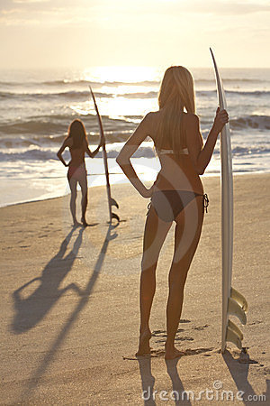 Women Surfers In Bikini & Surfboards Sunset Beach