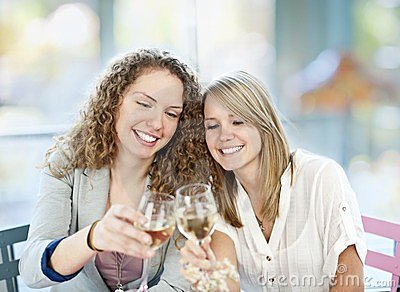 Women toasting with white wine