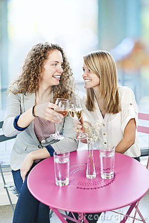 Women toasting with white wine
