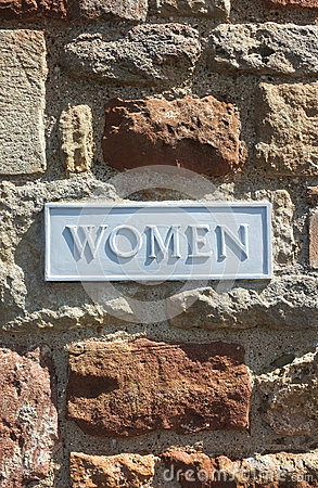Women Toilet Bathroom Sign on Brick wall