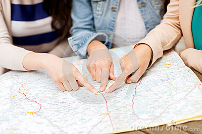 Women with tourist map in the city