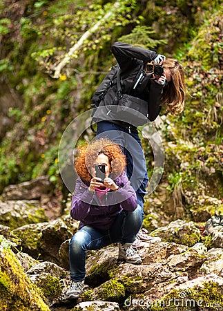 Women tourists taking photos