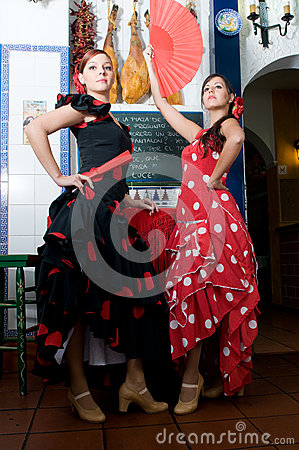Women in traditional flamenco dresses dance during the Feria de Abril on April Spain