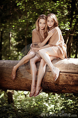 Women, twins in the forest