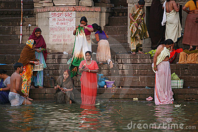 Women washing before ganges river vanarasi Editorial Image