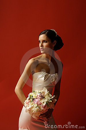 Women in Wedding Gown holding bouquet of Flowers