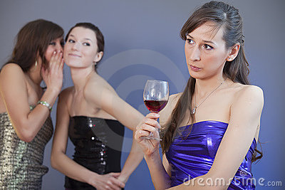 Women whispering on the party