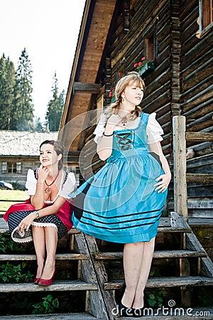 Women by a wooden Hut