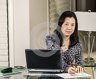 Women working on pie chart graphs from home office