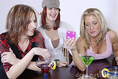 Women wth cocktails playing po