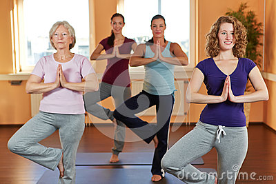 Women in yoga course in fitness