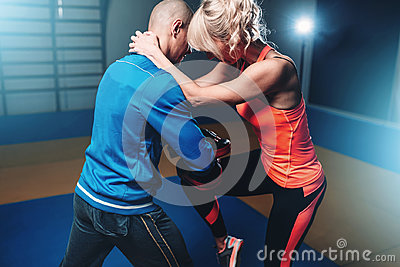 Womens self defense workout with instructor Stock Photo