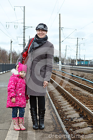 Wonam and child on railway station