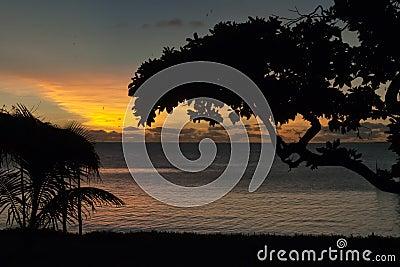 A wonderful sunset in tropical paradise sand beach