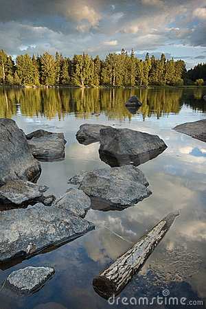 Free Wood And Stones In The Lake Stock Image - 4005441