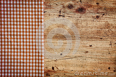 Wood background with checked napkin