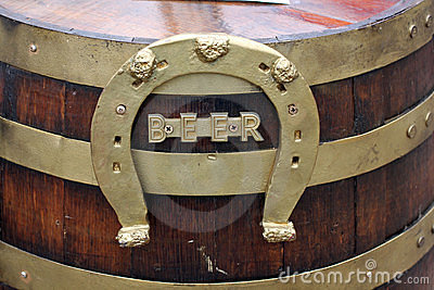 Wood beer keg with horseshoe