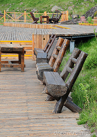 The wood bench on pavement board