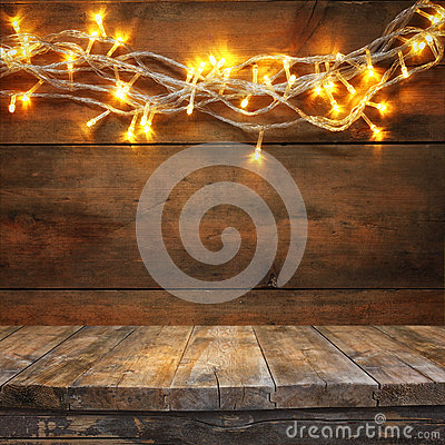 Free Wood Board Table In Front Of Christmas Warm Gold Garland Lights On Wooden Rustic Background. Filtered Image. Selective Focus Royalty Free Stock Photo - 59715955