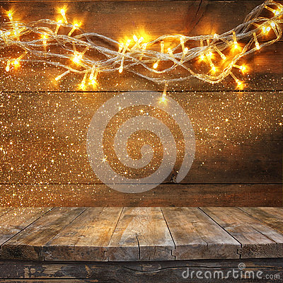 Free Wood Board Table In Front Of Christmas Warm Gold Garland Lights On Wooden Rustic Background. Filtered Image. Selective Focus. Stock Image - 59924601