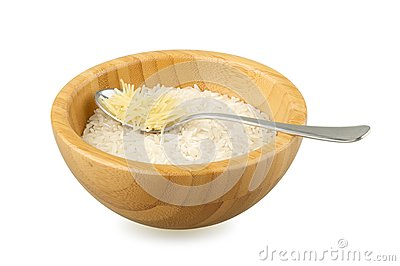 Wood bowl with rice and spoon with vermicelli