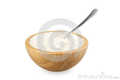 Wood bowl with rice and steel spoon