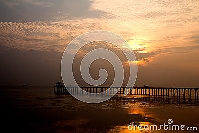 Wood bridge with seascape at twilight