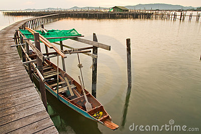 Wood bridge to fisherman house  in sea, Thailand