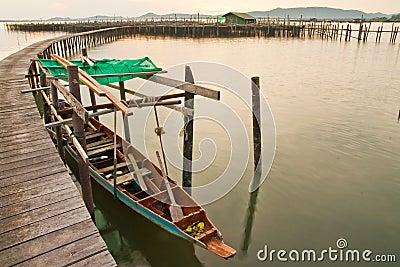 Wood bridge to fisherman house  in sea, Thailand
